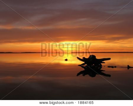 Sunset On Calm Water