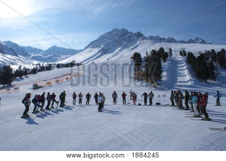 Group Of Tourists In The Alps