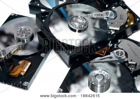 Close-up of a few open HDDs on white background