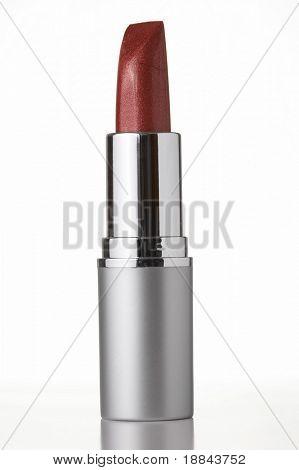 red lipstick on white background