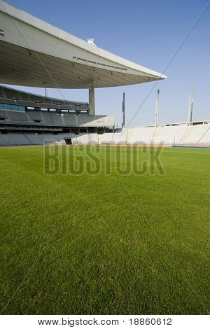 Empty Olympic Stadium With Green Grass Field