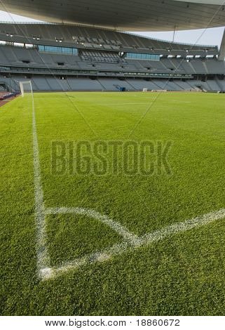 Green Grass Field And Corner Lines In An Empty Stadium Vertical Composition