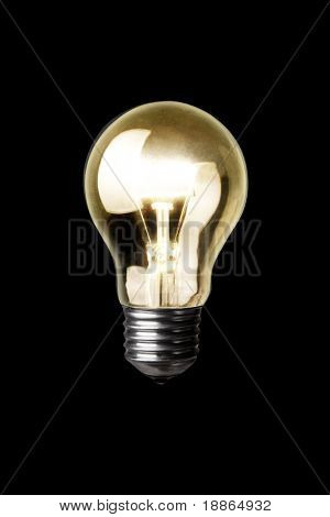 Classic Light bulb turned on isolated on black