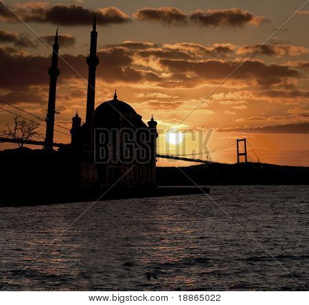 Sunset in Istanbul silhouette with Ortakoy Mosque and The Bosphorus Bridge