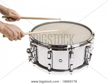 Male hands playing big metal snare drum isolated on white with sticks