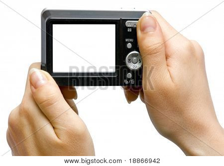 The digital camera with the white screen in hand on white background