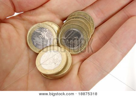 coins on a hand with clipping paths