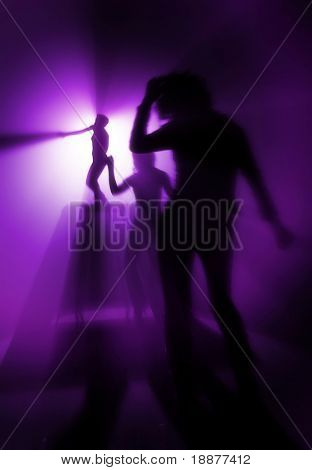 silhouettes of people on discothque in purple light