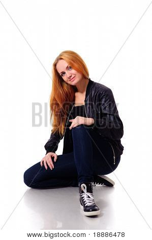 sitting funky young woman isolated on white