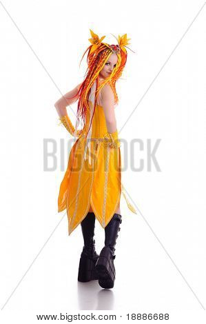 Studio shot of posing woman in bright yellow latex clothing