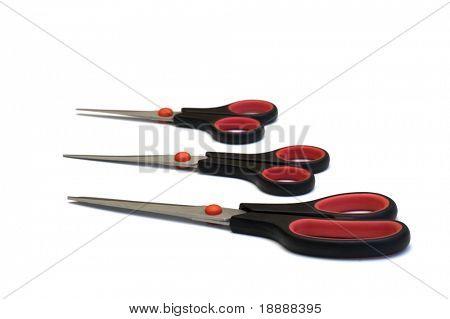 three scissors on white background