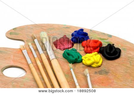 painting brushes and palette on white background