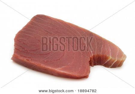 raw tuna steaks on white background