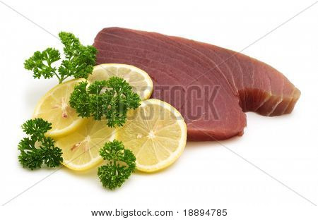 raw tuna steaks on white background