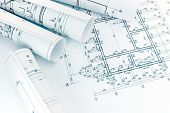 Rolls Of Architecture Blueprints With Floor Plan Drawing On Architects Workspace poster