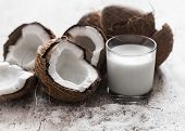 Coconut On Wooden Background poster
