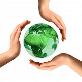 stock photo of world-globe  - Conceptual recycling symbol made from hands over Earth globe Environment and ecology concept - JPG