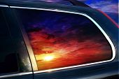 picture of car-window  - The sunset is reflected in car glass - JPG