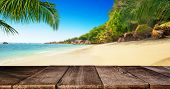 Tropical beach with empty wooden table, summer holiday background. Travel and beach vacation, free s poster