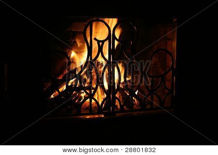 A conflagrant fire is in a fire-place