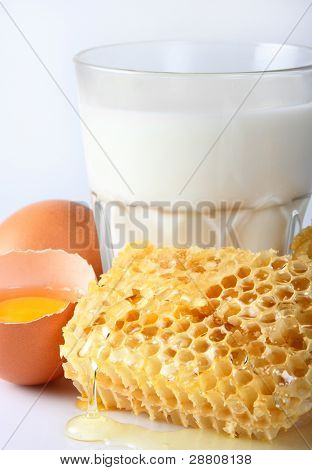 Milk with honey. Use it for a health and nutrition concept.