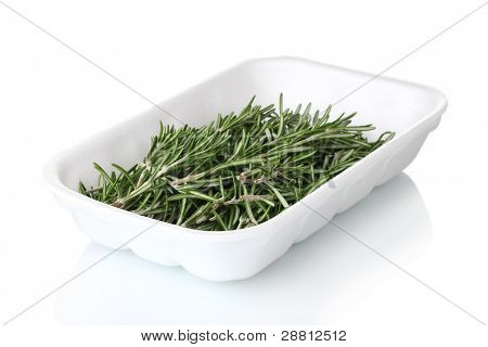 fresh green rosemary in the package isolated on white