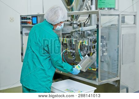 Pharmaceutical industry technician works with