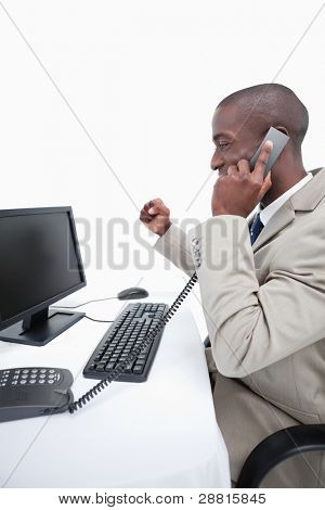Portrait of a cheerful businessman making a phone call against a white background