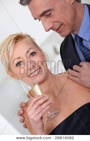 Middle aged couple having champagne.