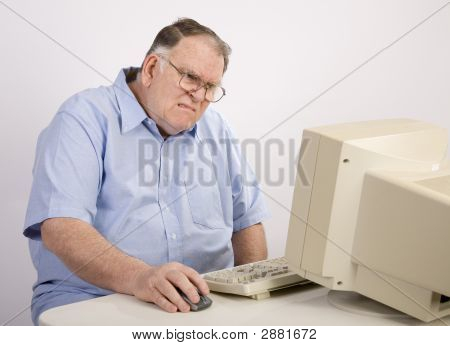 Old Guy At Computer Grimacing