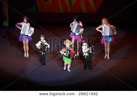 MOSCOW - MARCH 17: unidentified members of Folk music at concert of Gennady Ledyakh School of Classical Dance in theater Et Cetera, on March 17, 2011 in Moscow, Russia. Concert held for winners in competition.
