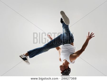breakdancer frozen in mid head spin, classic modern hip hop or break dance move