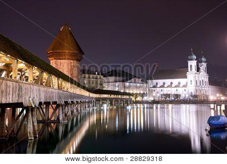 Famous wooden Chapel bridge foot walkway in Lucerne, Switzerland