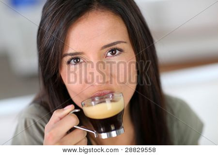 Portrait of beautiful woman drinking expresso