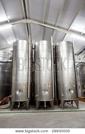 modern winery with large stainless steel barrels
