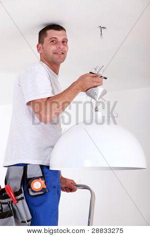 Man fitting light