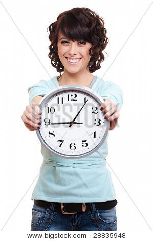 smiley young woman with clock. isolated on white background