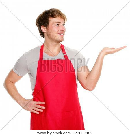 Apron man showing. Small business shop owner showing and looking wearing red apron. Happy smiling and proud caucasian man presenting isolated on white background.