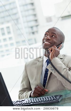 Portrait of an office worker on the phone looking away from the camera