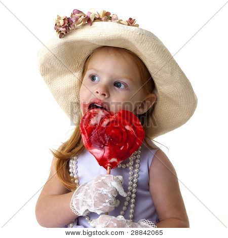 little girl with a giant heart-shaped lollipop