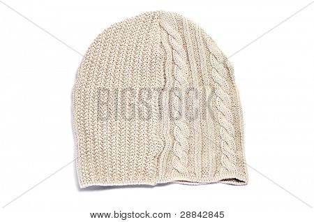 a beige tuque on a white background