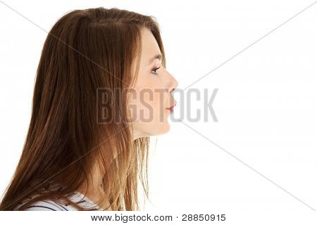 Site view face closeup portrait of a young beautiful caucasian teen sending a kiss, on white.