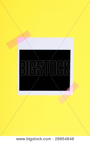 Photo paper glued on yellow paper isolated on white