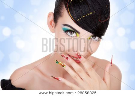 Beautiful young  woman giggles.  Fashion model with nice hair, make-up, manicure.