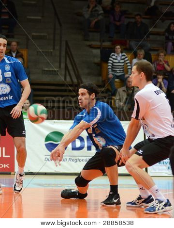 KAPOSVAR, HUNGARY - JANUARY 8: Andras Geiger (C) in action at a Hungarian volleyball National Championship game Kaposvar vs. Dag, on January 8, 2012 in Kaposvar, Hungary.