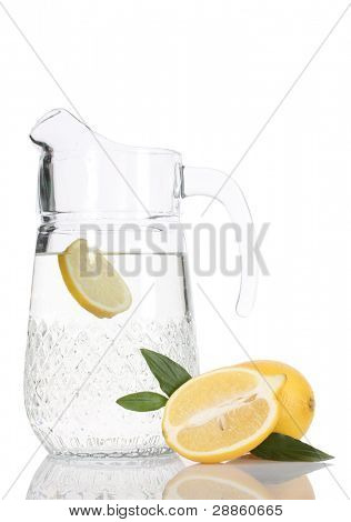 pitcher of lemonade and lemon isolated on white