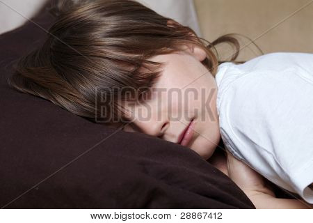Young boy have a nap on sofa