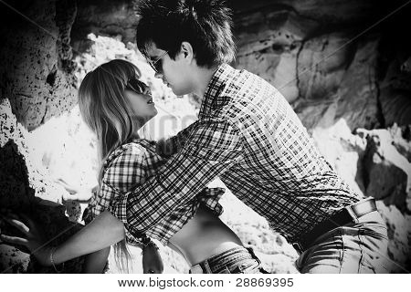 Young couple in love outdoors. Black and white.