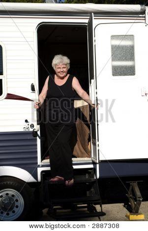 Woman In Door Of Trailer