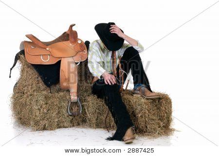 Cowboy On Hay